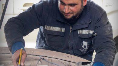 Photo of جانب من عمل قسم المرآب والآليات في معبر باب الهوى