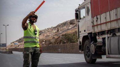 Photo of جانب من أعمال شرطة المرور في تنظيم السير بمنطقة معبر باب الهوى